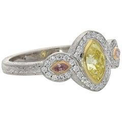 Hancocks Fancy Yellow and Pink Diamond Ring with Diamond Surround