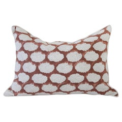 Hand Blocked Gray and Rust Color Accent Pillow on White Linen Background
