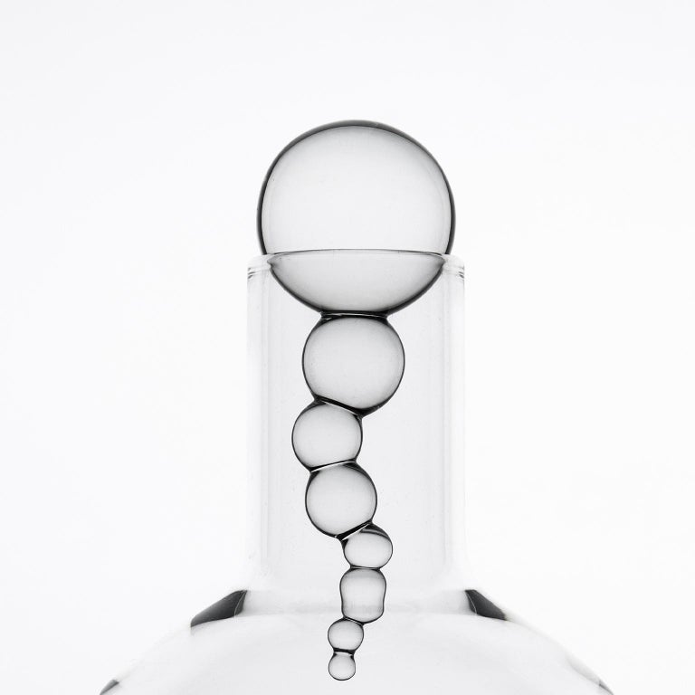 Hand blown bottle from Alchemica Collection. A collection composed of bottles, wine glasses, cocktail glasses and whiskey glasses, born from an ironic reinterpretation of chemical laboratory glassware. Vials, test tubes, funnels and cylinders are