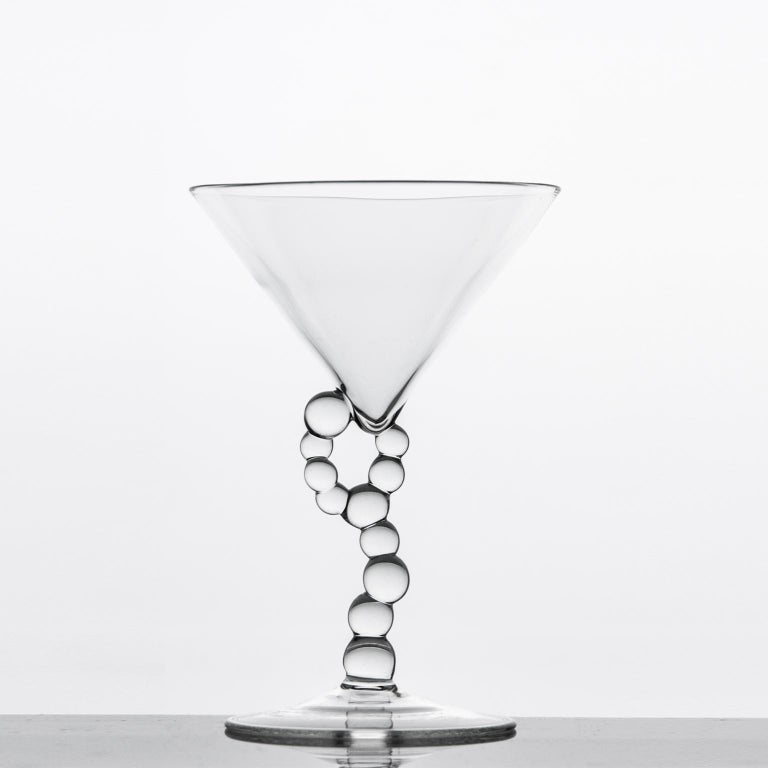 'Alchemica Martini Glass' Hand Blown Glass by Simone Crestani  Alchemica Martini Glass is one of the pieces from the Alchemica Collection.  Alchemica Collection: A collection composed of bottles, wine glasses, cocktail glasses, and whiskey glasses,