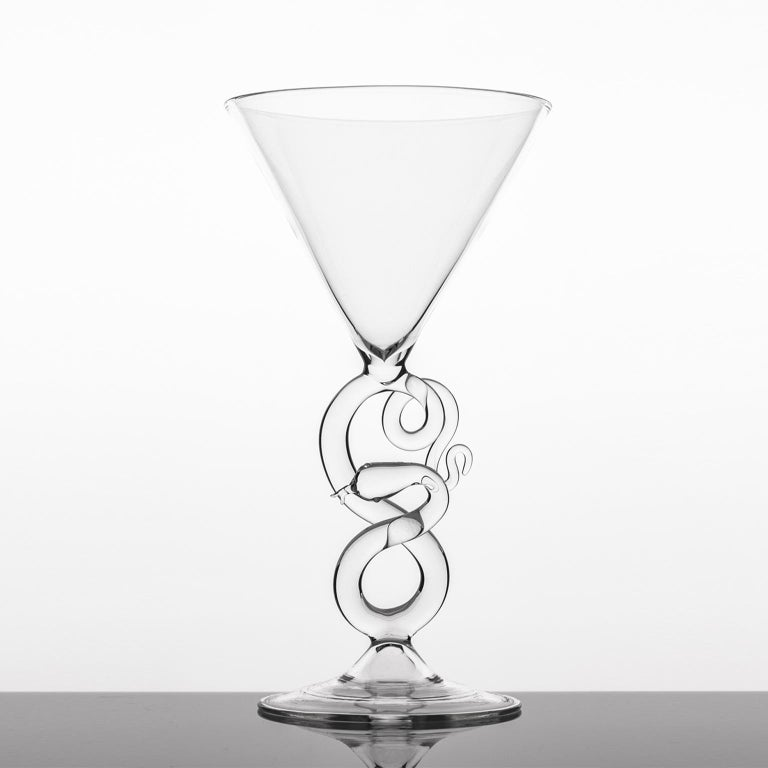 Band blown Martini glass from Serpentine Collection. Collection of serpentine table objects composed of liquor bottles, martini glasses, and ashtrays. Inspired by the snake iconography of the18th century prints, the vices are represented with their