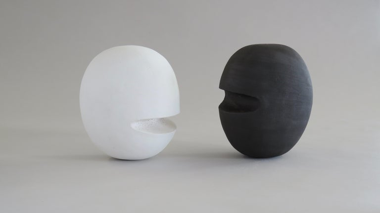Hand-Built Ceramic Heads, hollowed out in the construction for lightness, they are finished in a soft matte white underglaze. Inspired by the need for better communication in the world, this series of heads may stand or lie, sometimes where the