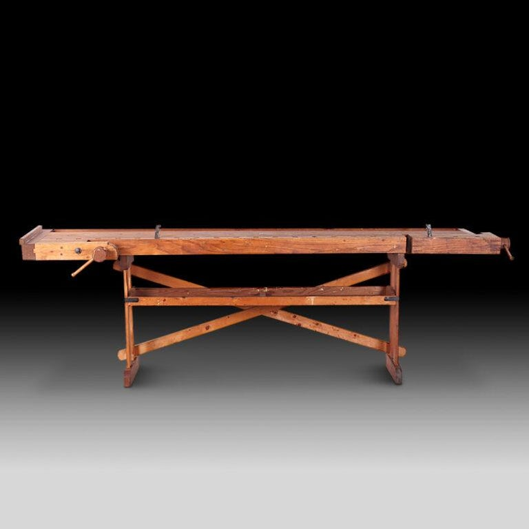 Made in Saskatchewan in the early 20th century, this workbench was built by a farmer and craftsman who immigrated from Norway in 1910. Very good original condition with two functioning vices- nice dovetail joinery on one. Just acquired from the