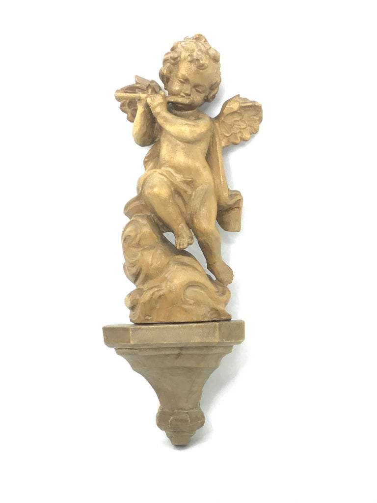 Beautiful hand carved wooden cherub angel, found at an estate sale in Germany. We believe that this piece is from the mid-20th century. A nice addition to any room. Comes with a wall console, beautiful to display as seen on the picture. Measures: