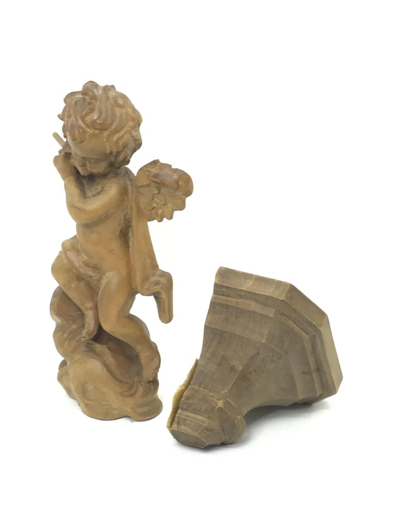 Mid-20th Century Hand Carved 20th Century Wooden Cherub Angel Playing Flute and Wall Console For Sale