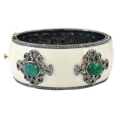 Carved 9.8 Carat Emerald Enamel Diamond Bangle Bracelet