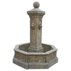 Hand Carved Aged Marble Fountain with Pool and Four Lion Heads