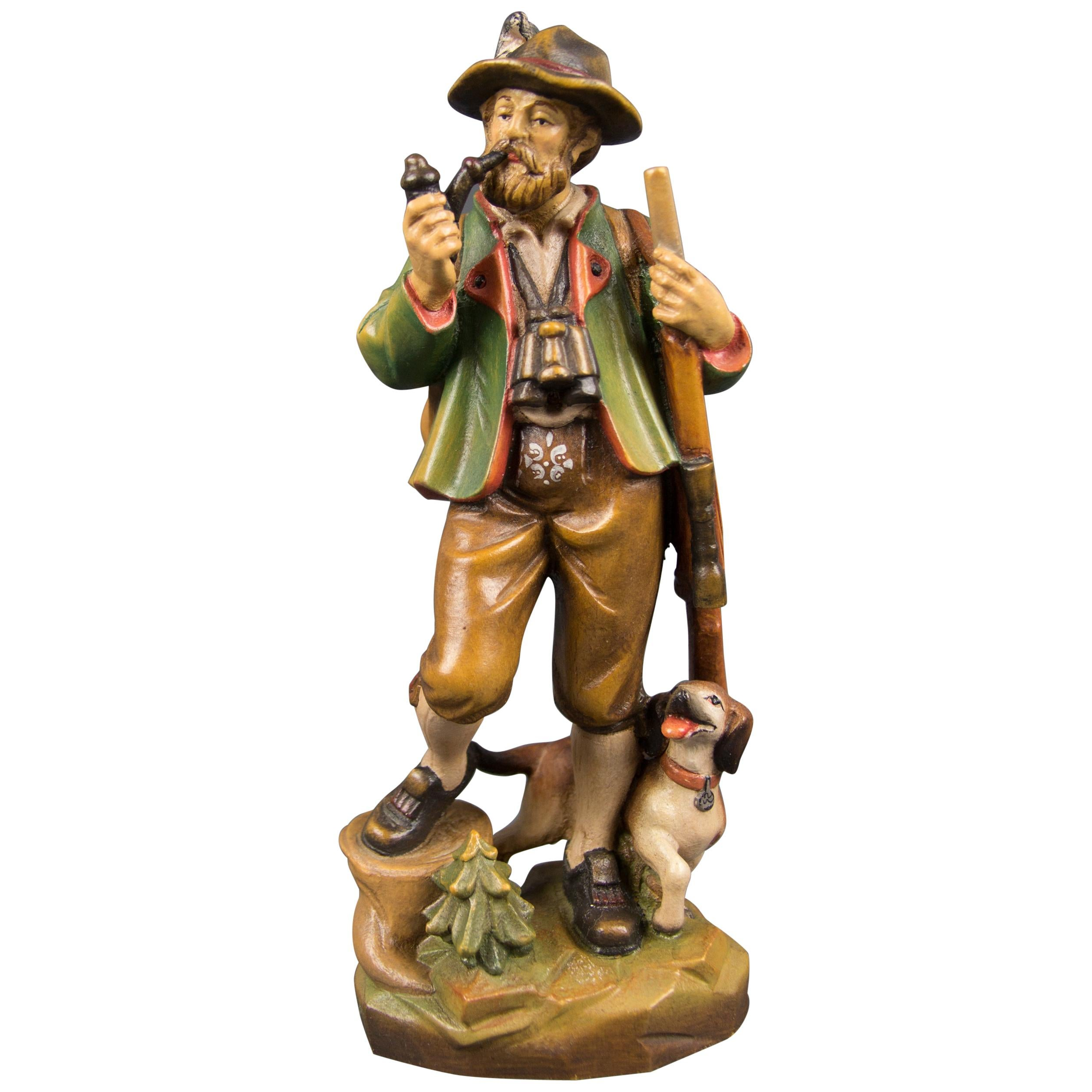 Hand Carved and Hand Painted Wooden Sculpture of a Hunter with Dog