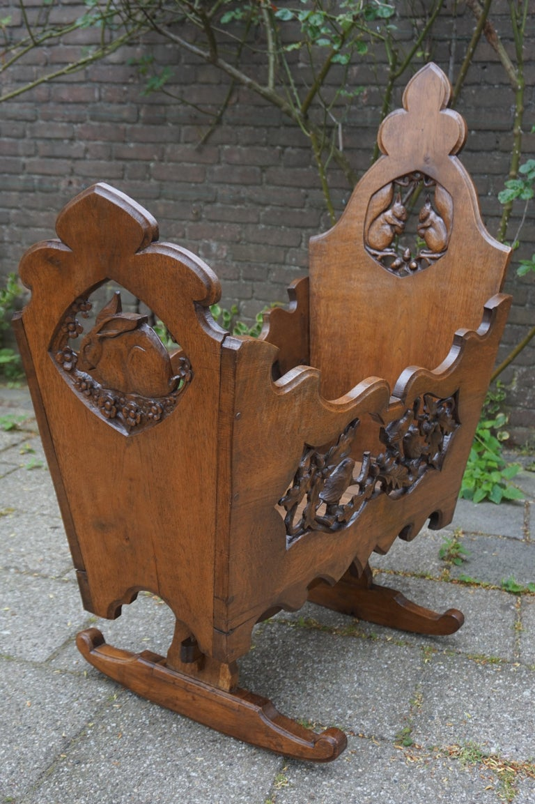 European Hand Carved Arts & Crafts Baby or Doll Bed / Crib with Squirrel Rabbit & Sparrow For Sale