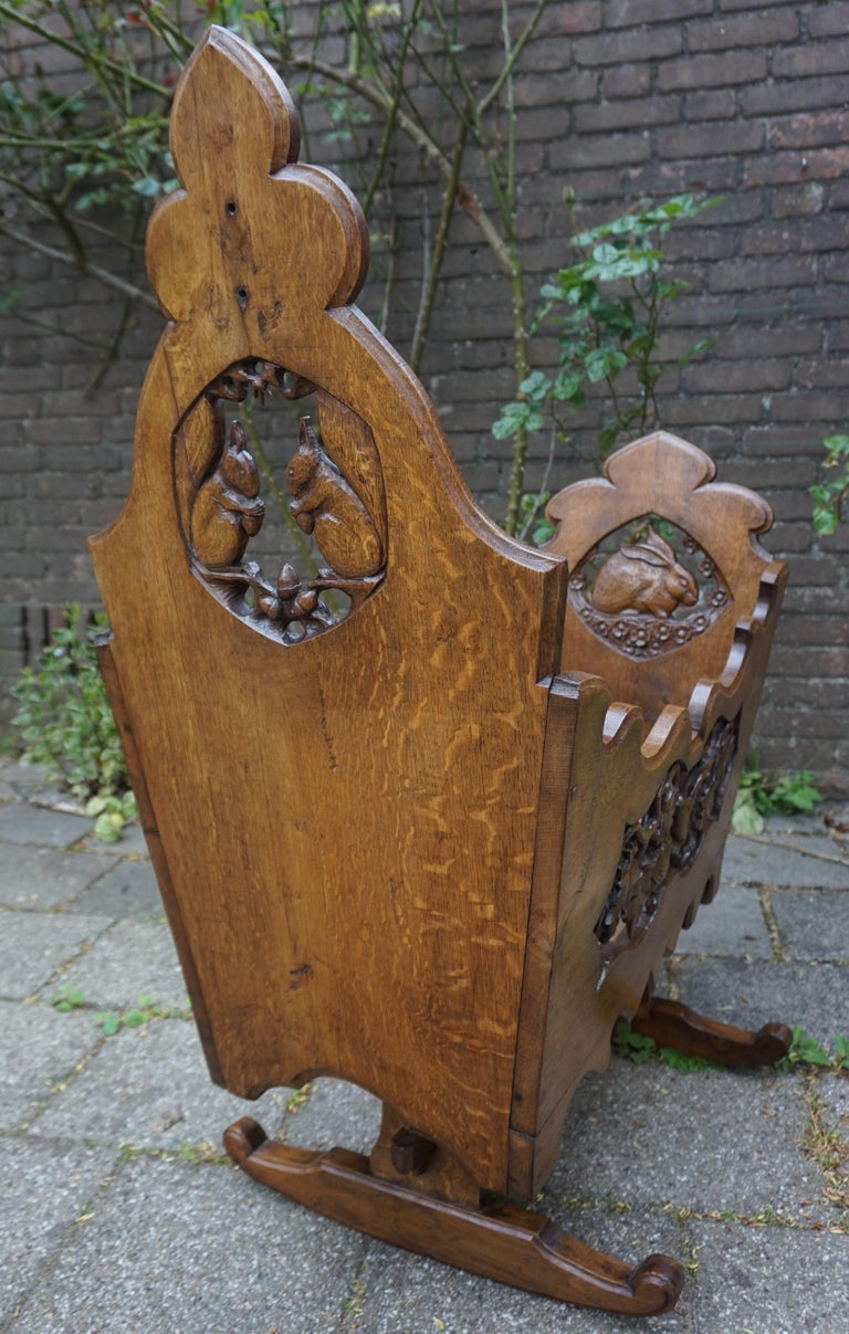 Hand-Carved Hand Carved Arts & Crafts Baby or Doll Bed / Crib with Squirrel Rabbit & Sparrow For Sale