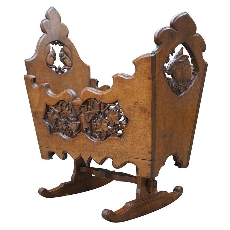 Hand Carved Arts & Crafts Baby or Doll Bed / Crib with Squirrel Rabbit & Sparrow For Sale