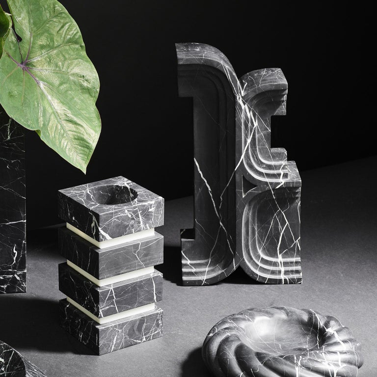 Avanzo by Greg Natale, is an Italian marble curio that evokes historical architectural references and a nod to Carlo Scarpa through its intricate, stepped detailing.