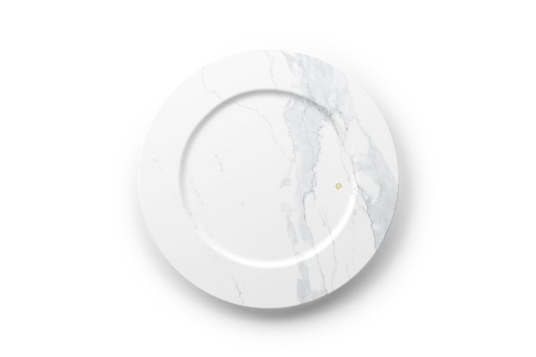 Hand carved charger plate from statuary marble. Multiple use as charger plates, plates, platters and placers. Dimensions: D 33, H 1.9 cm.  The precious white statuary marble has always been the one preferred by sculptors and artists for their