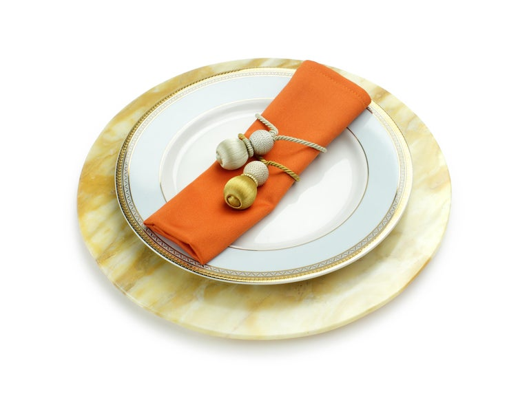 Hand carved charger plate from Yellow Siena marble. Multiple use as charger plates, plates, platters and placers. Dimensions: D 33, H 1.9 cm.