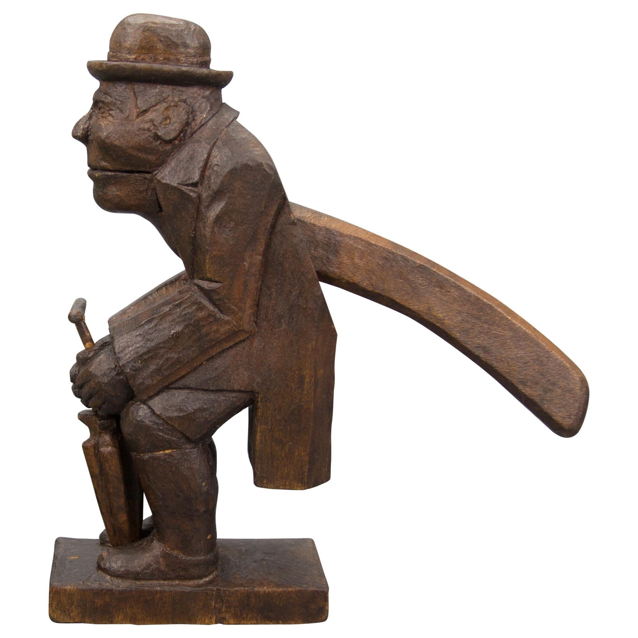 Hand Carved Dark Brown Wooden Figural Nutcracker of a Man, Germany, 1930s