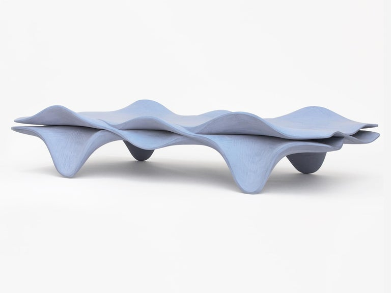 Interlocking hand-carved Tulipwood and milk paint daybed by Hudson Valley-based artist Christopher Kurtz, based on design elements from traditional Windsor furniture. Shown in a blue milk paint. Custom sizing and finish available per request.