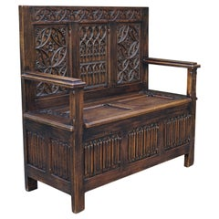Hand Carved Early 20th Century Gothic Revival Hall Bench with Lid and Trunk