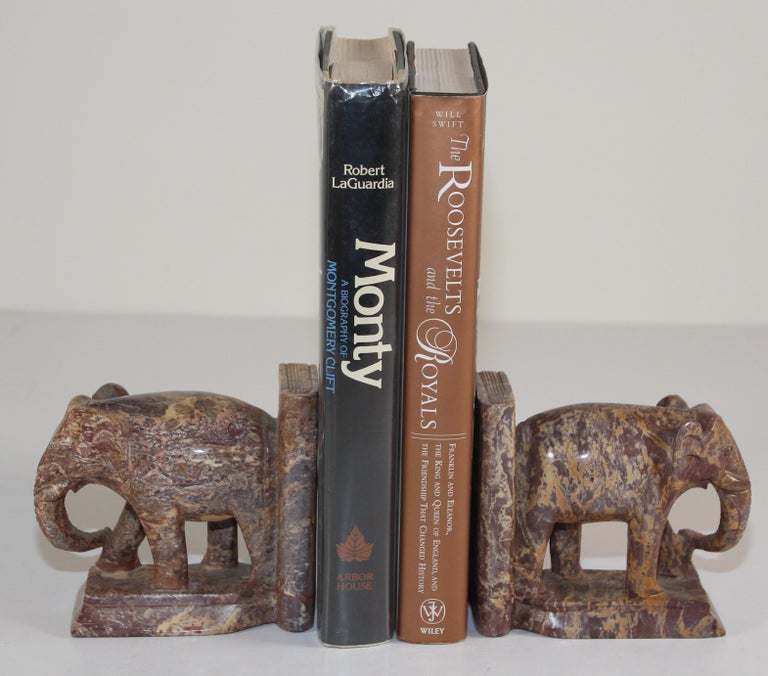 Hand-carved asian elephant marble sculpture bookends, 1950s Nice vintage pair of hand crafted brown marble elephant bookends. Vintage bookshelf decor elephants bookends animal sculpture. These are hand carved and therefore not completely