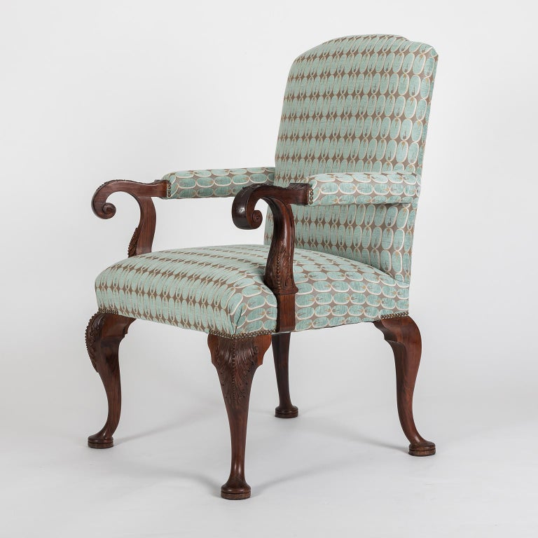 This very elegant and Classic armchair, has beautiful hand carved details in the solid Mahogany structure. It was restaured and re-upholstered in a blue and grey Kravet design fabric.  Dimensions: Width 72 cm; depth 72 cm; seat depth 60 cm;