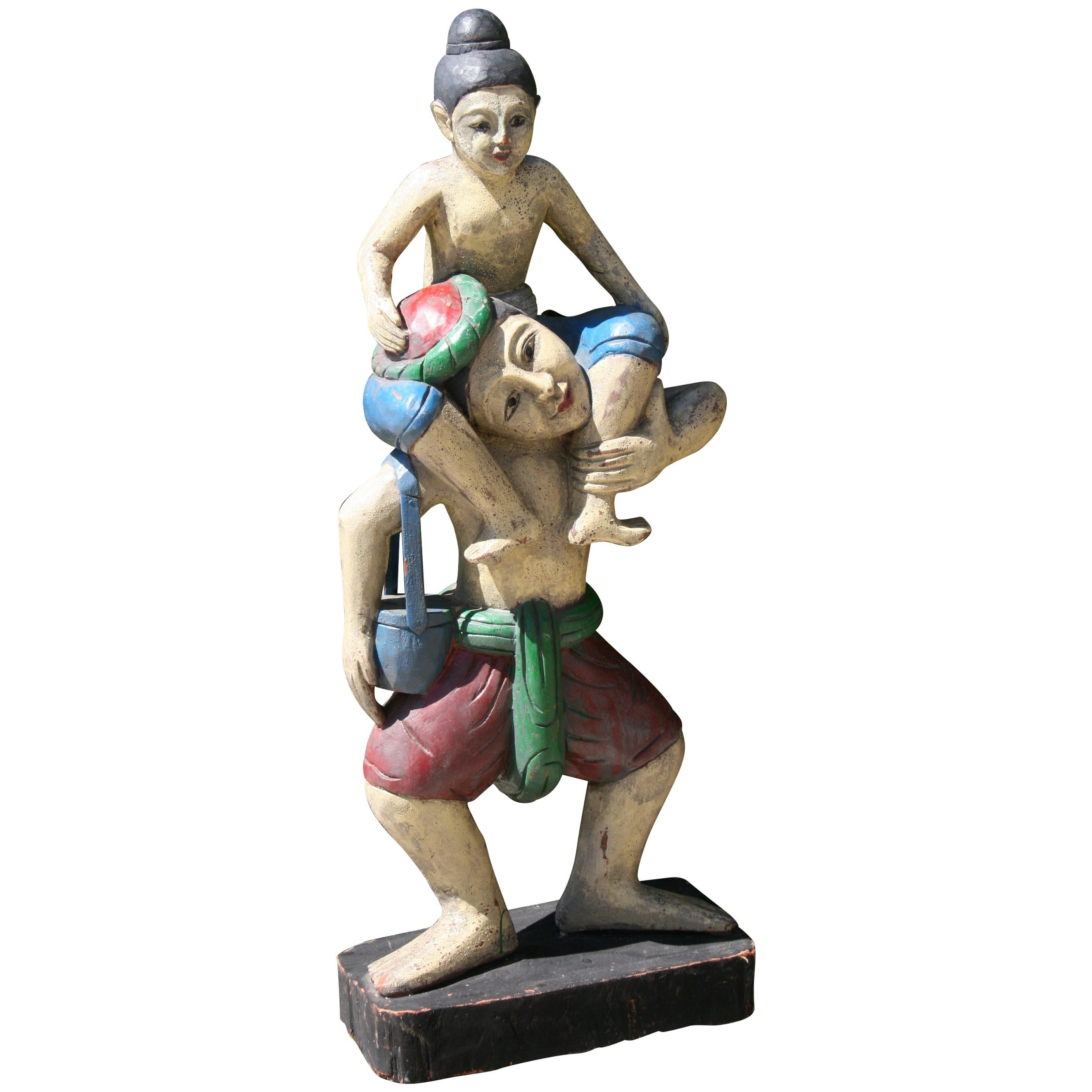 Hand Carved Oversized Father and Son Polychrome Folk Art Figural Statue