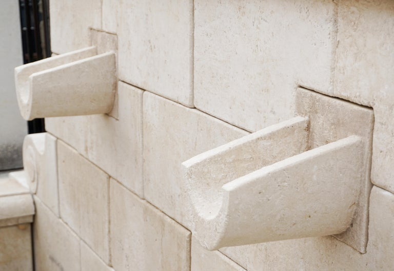 Here we offer a large two-spouted, hand carved limestone wall fountain. This piece has very straight lines and can add to any design.   Origin: France  Measurements: 60 1/4