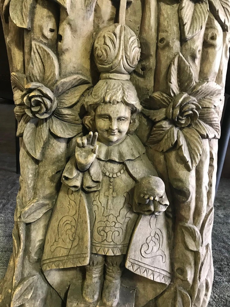 A wonderful, intricately carved, heavy work depicting a religious figure, likely a catholic saint offering his blessing. Perhaps featured in a church or nunnery at one time.  We are listing as 19th century but could be older.  Carved from heavy