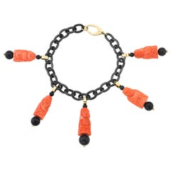 Hand Carved Italian Coral with Onyx, Yellow Gold, Blackened Steel Charm Bracelet