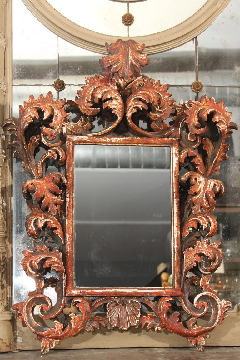 Highly carved wood frame mirror, nice size and great color. Italian. Original mirror has been replaced.