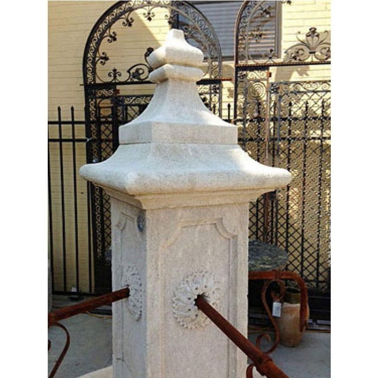 Here we offer a custom hand carved limestone central fountain with four down spouts. This fountain was designed after an antique village fountain recovered by our partners in France, but the size was adjusted to meet a clients needs. The ability to