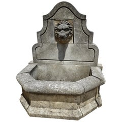Hand Carved Limestone Wall Fountain with Lion Medallion