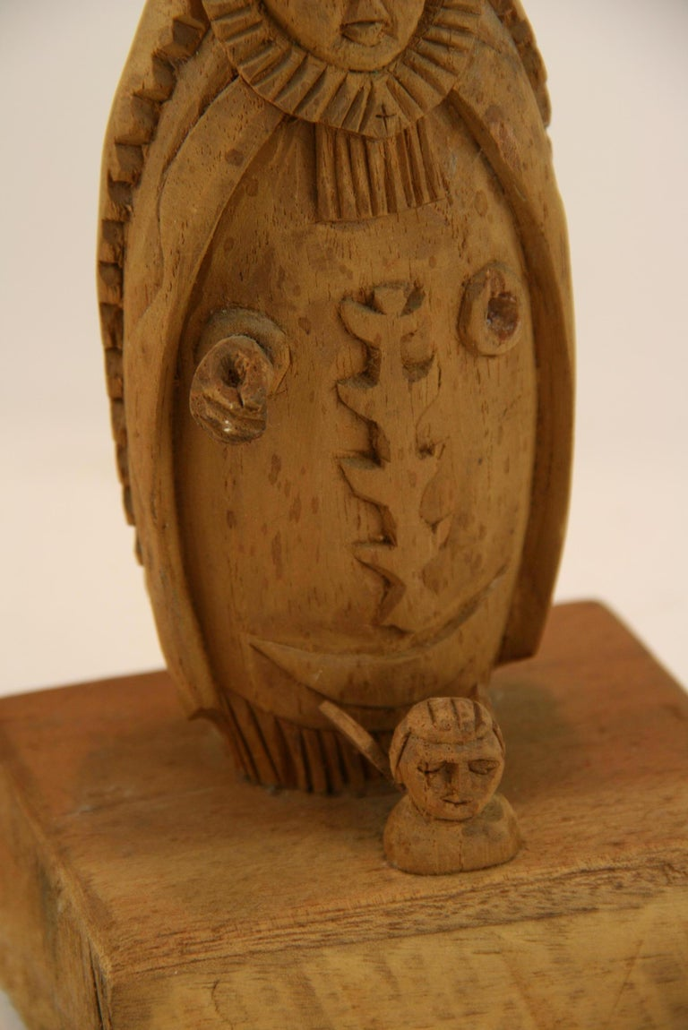 Folk Art Hand Carved Madonna Santos with Putto In Good Condition For Sale In Douglas Manor, NY