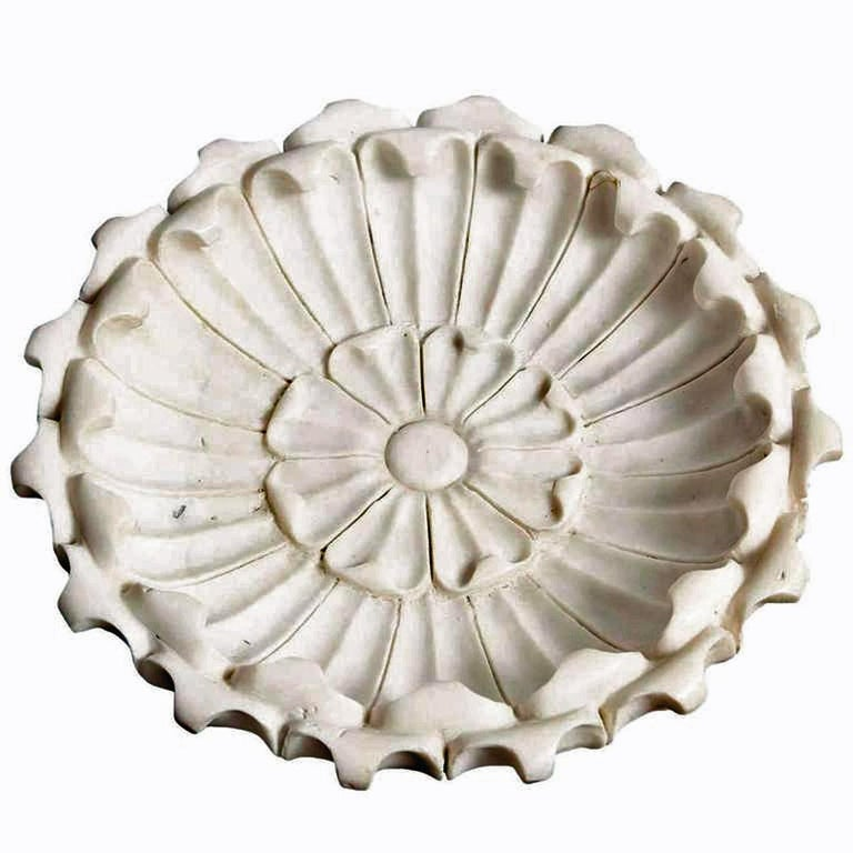 A delicately hand carved, large shallow bowl with a floral motif. From India. White marble with fine veining, circa 1960. Dimensions: 22 1/2