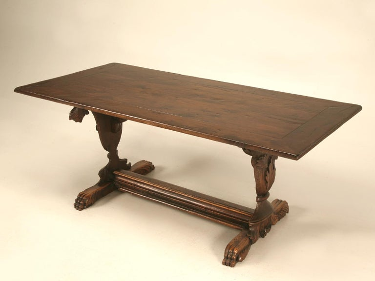 18th century hand carved solid walnut trestle table. This table offers breathtaking beauty with its incredible urn-form pedestals overflowing with decorative leaves and vines. Sturdy and solid construction showcase old world craftsmanship, as do the