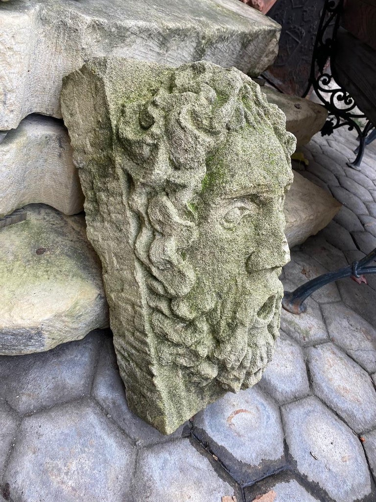 A beautiful sculpture hand carved fountainhead of a bearded man. It could be installed with a simple water spout or as is. You can pair it with a stone trough basin to create a charming garden water fountain feature we have many available options of