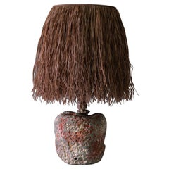 Hand Carved Stoneware Pacific Table Lamp with Raffia Shade by LGS Studio