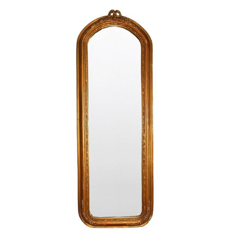 Hand-Carved Tall Giltwood Mirror in the style of Louis XVI For Sale