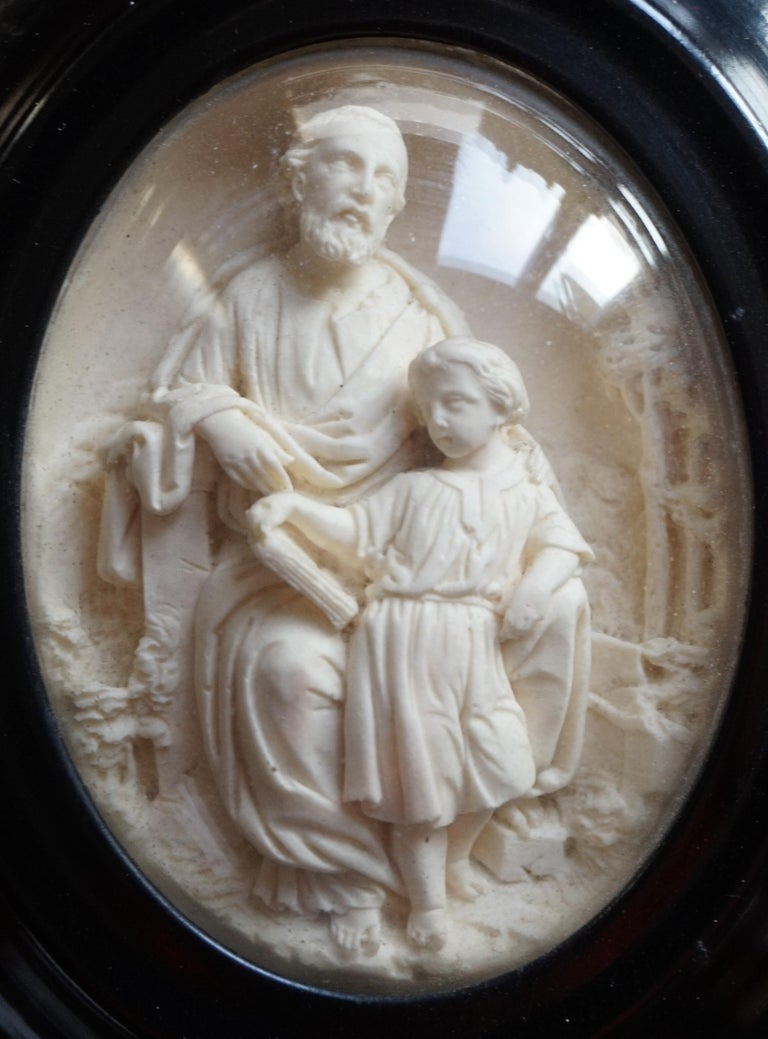 Glass Hand Carved Wall Plaques with Sepiolite Sculptures of Mary Jesus and Joseph For Sale