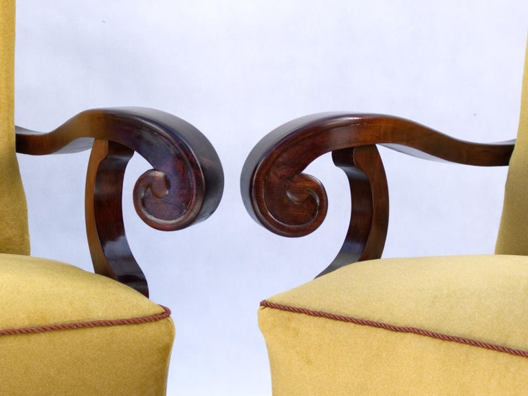Fully restored large Art Nouveau armchairs in Otto Prutscher style. Hand carved walnut and new upholstery.