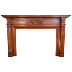Hand Carved Walnut Mantle with Acanthus and Daisy Centerpiece