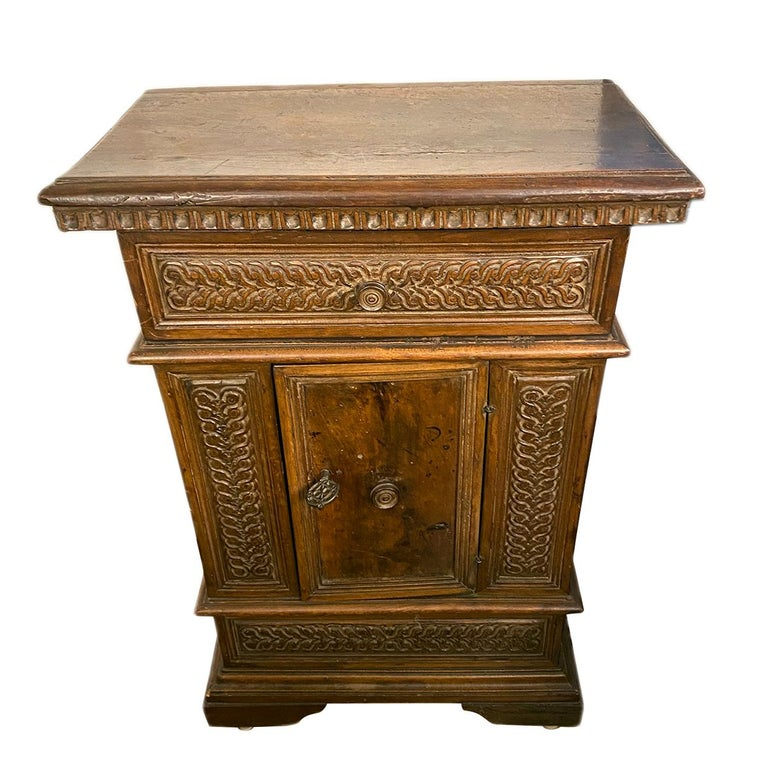 An Italian late 19th century hand carved wood cabinet.