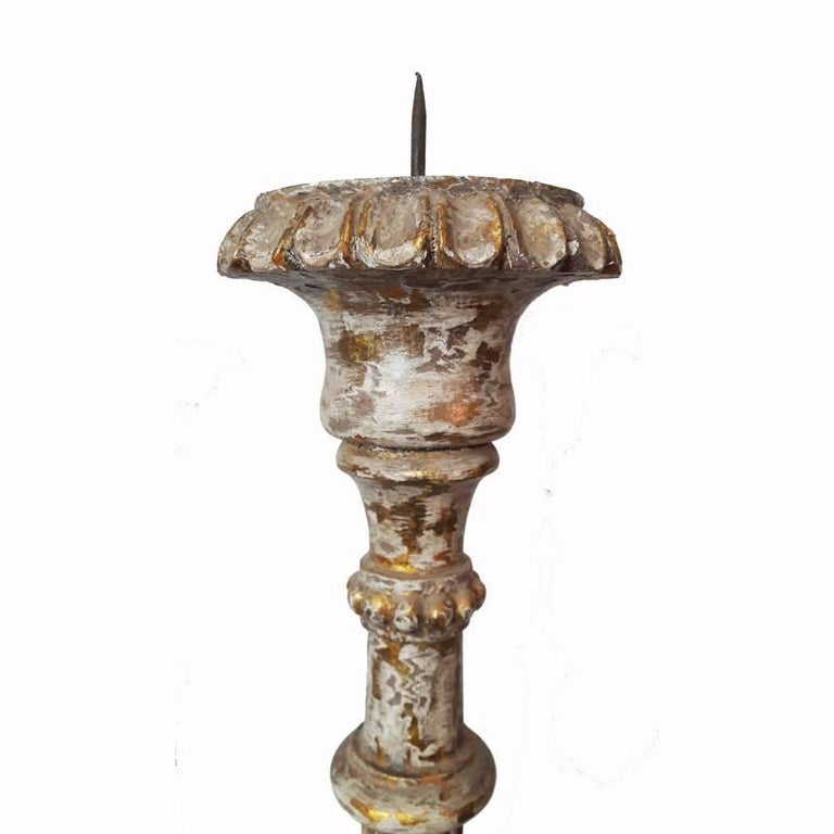 Tall, hand-carved wood candlesticks from India.