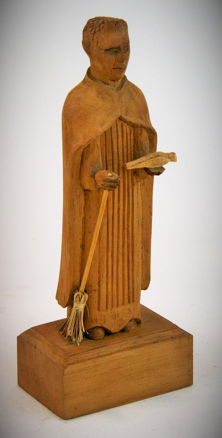 3-456 hand carved wood friar Santos with dove.