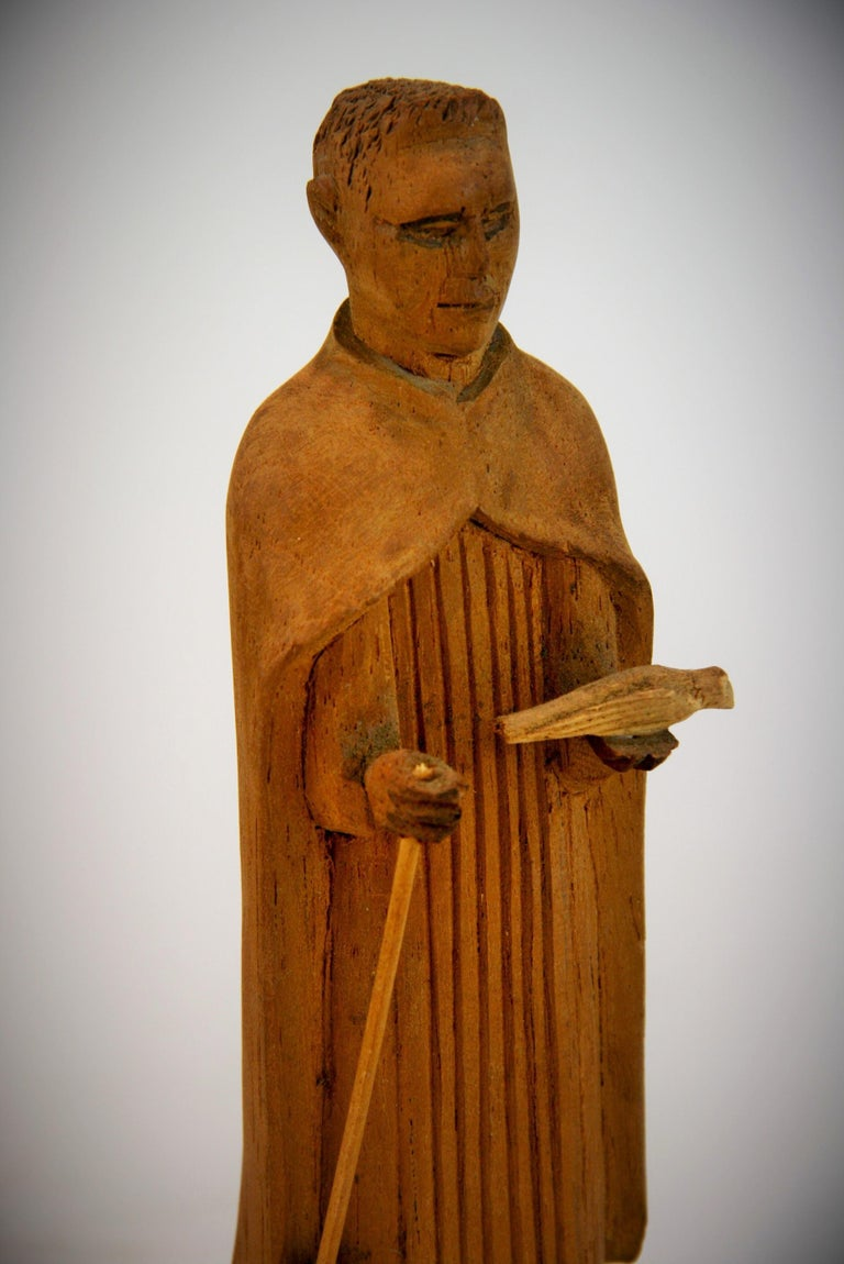 Folk Art Hand Carved Wood Friar Santos with Dove In Good Condition For Sale In Douglas Manor, NY
