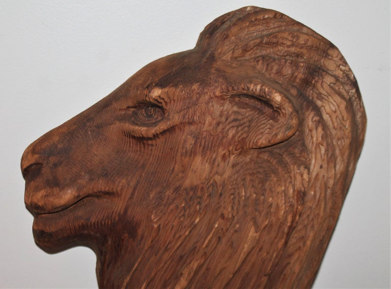Early 20thc hand carved wood lion head from one solid piece of wood. Great form and proportional.