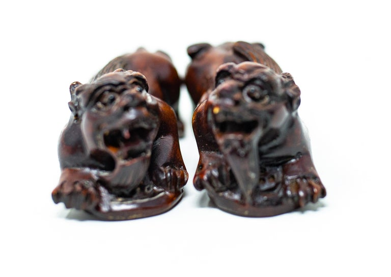 20th Century Hand Carved Wooden Foo Dogs For Sale