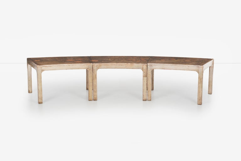 Handcrafted and painted Max Kuehne coffee table set of three. Images show versatility as single table curved, straight or as individual tapered end tables. Known primarily as a painter, over the years, Max Kuehne had a successful career as a wood