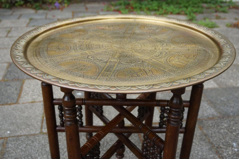 Stylish and meaningful early 20th century Egyptian tray table.  If you are decorating your home, a room or a business with an Egyptian theme then this foldable tray table could be perfect. This handcrafted table from the 1920s mixes the best of two