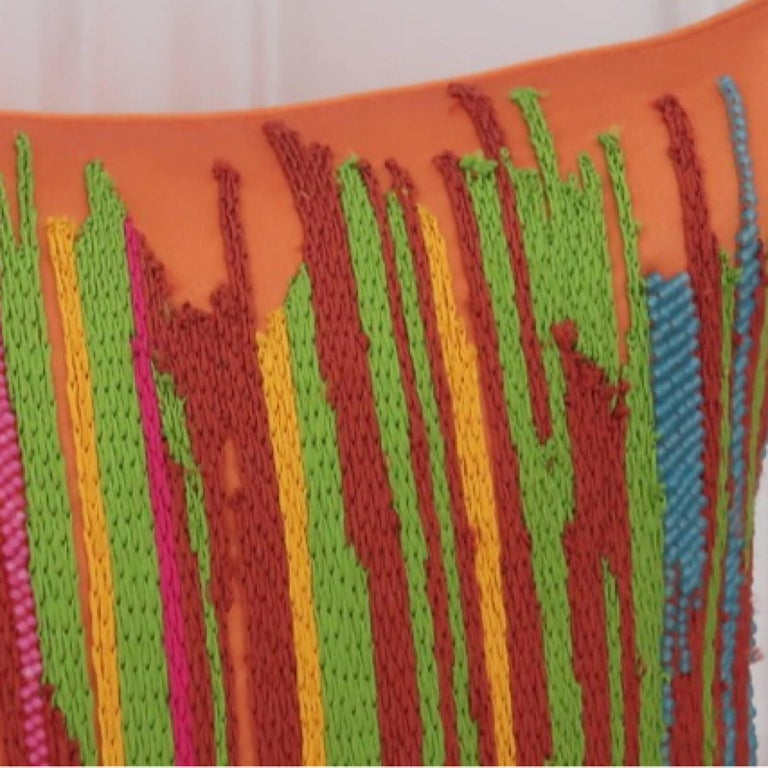 Hand embroidered pillow. Handcrafted using Matt beads and cotton yarn embroidered in brightly colored stripes on a orange background. Satin fabric, self zip and feather pads.