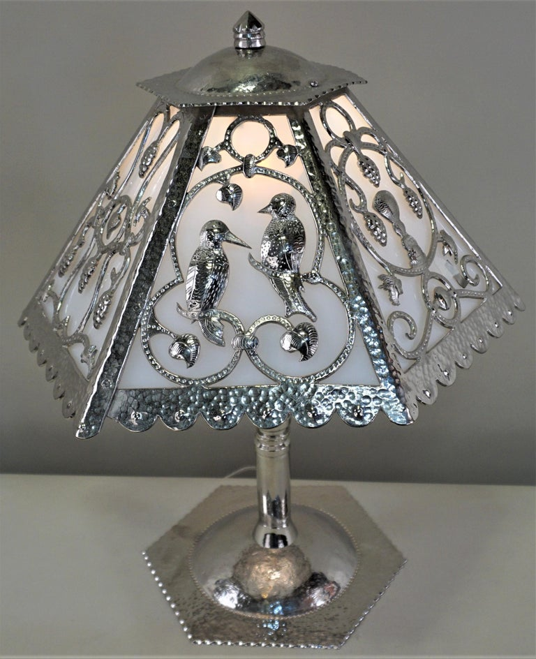 Handcrafted metal work, a rare and one of a kind French Art Deco table lamp. A metal smith masterfully created a six-panel shade, each with a different design, from three sections of heavy gauge bronze using a chisel and hammer. Base was created