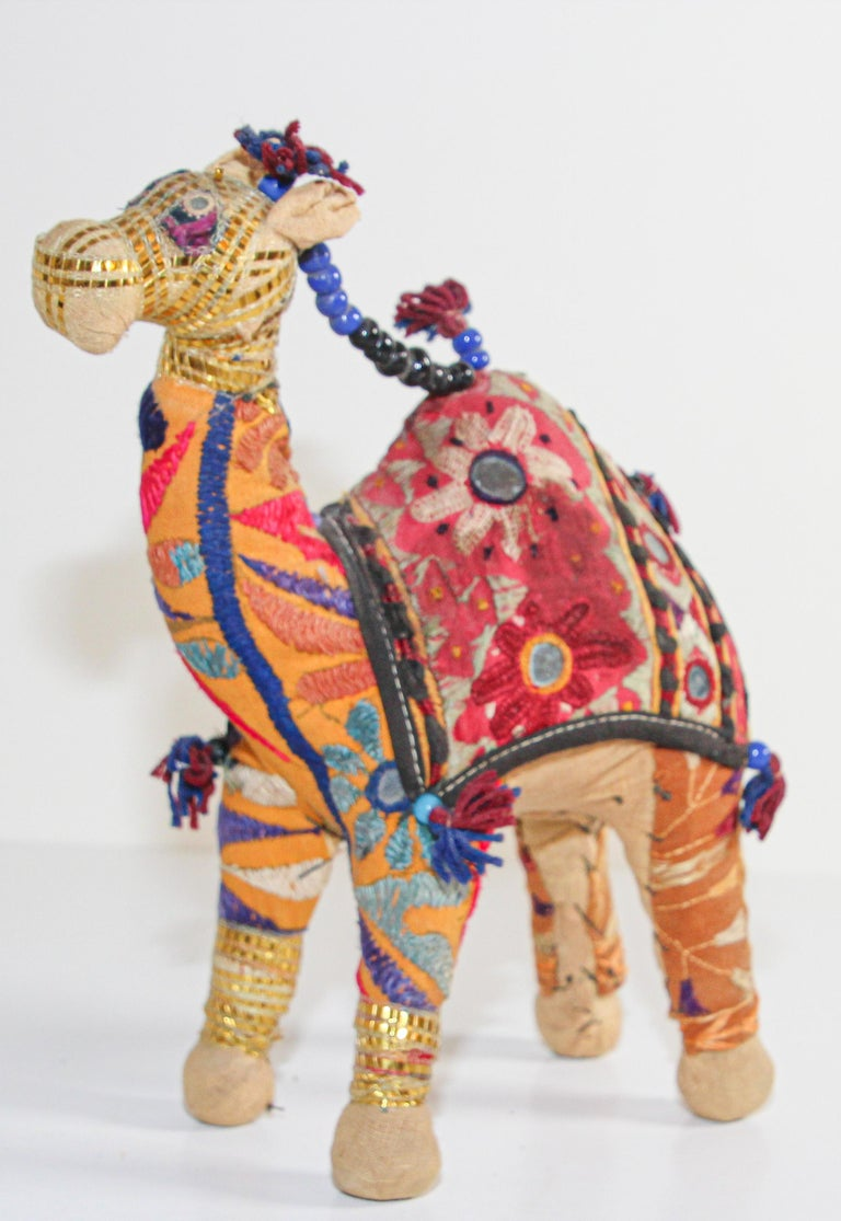 Handmade in Rajasthan, India, colorful fabric camel toy. Vintage small camel stuffed cotton embroidered and decorated with small mirrors, great collector piece. Anglo Raj, small stuffed camel wearing the ceremonial folk attire made from embroidered